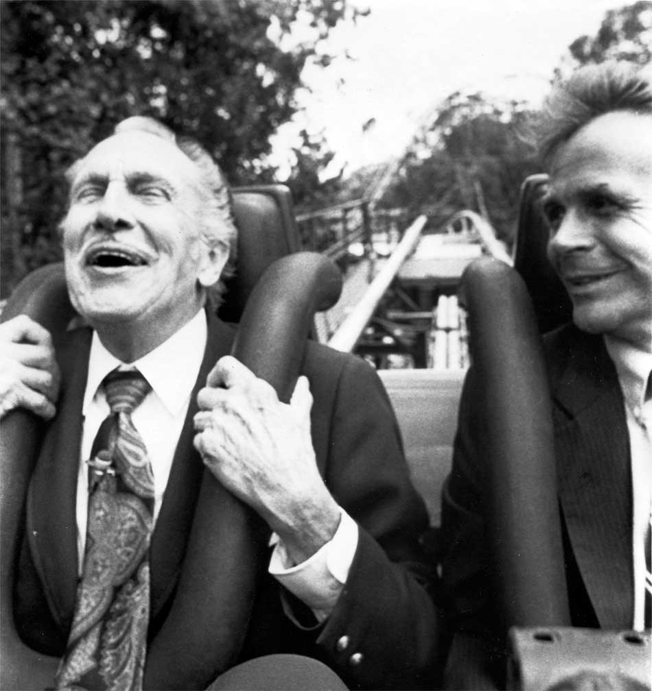 vincent-price-riding-the-loch-ness-monster-roller-coaster-with-c-michael-cross-at-busch-gardens-in-williamsburg-1984